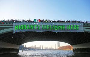 migrant banners1 300x192 Anti Trump Protest in London, UK