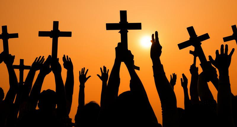 silhouette of cross held up at sunset on shutterstock 800x430 Home