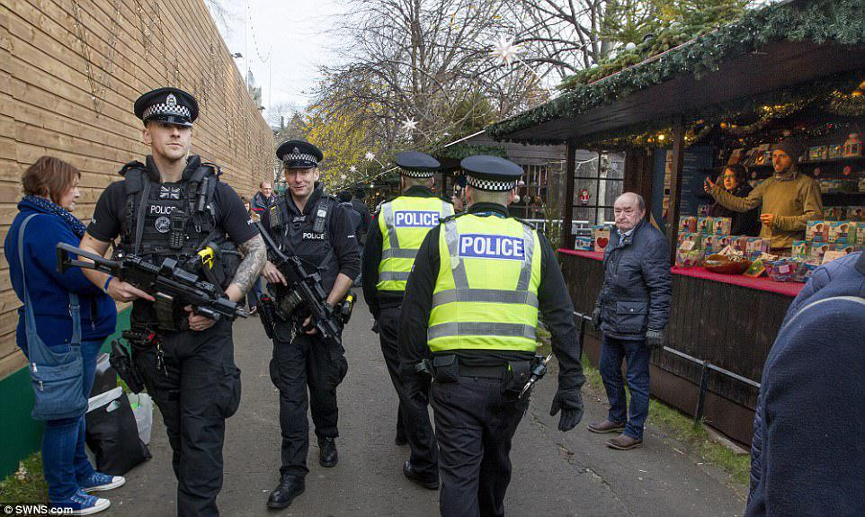 4689432F00000578 5100087 image a 55 1511179276599 How Britain celebrates Christmas in 2017: Armed guards, concrete barriers and metal detectors spring up around festive markets due to terror attack fears