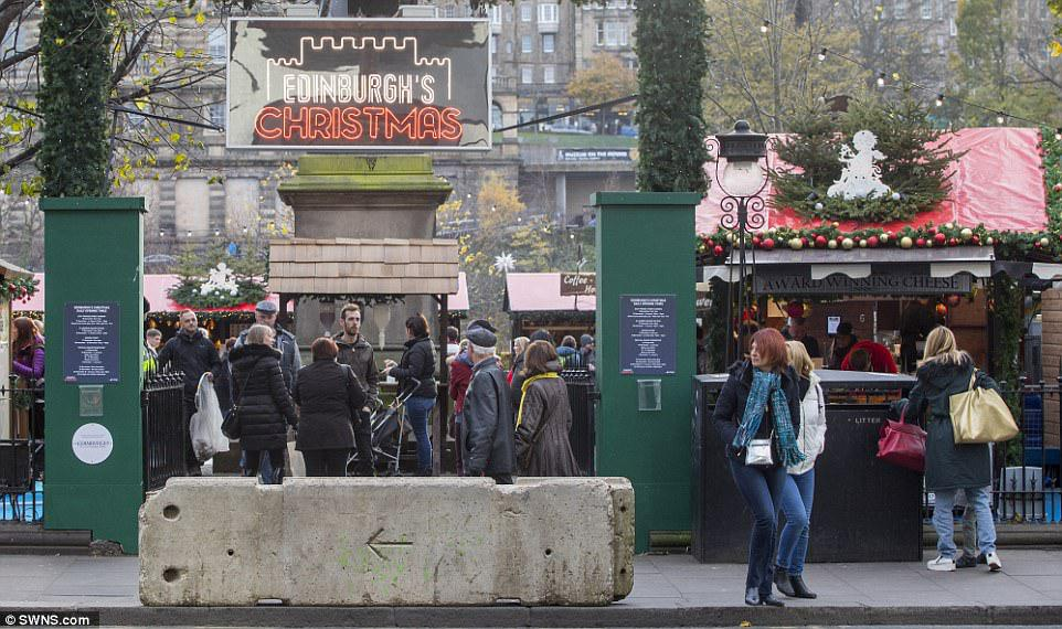 4689463A00000578 5100087 image a 44 1511179198194 How Britain celebrates Christmas in 2017: Armed guards, concrete barriers and metal detectors spring up around festive markets due to terror attack fears A large concrete block sits on the pavement outside an entrance to Edinburghs Christmas market to stop vehicles smashing their way in and harming visitors